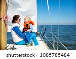 mother and baby boy sail on... | Shutterstock . vector #1085785484