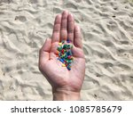 microplastics picked up on a... | Shutterstock . vector #1085785679