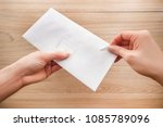 woman's hand holds and opens a... | Shutterstock . vector #1085789096