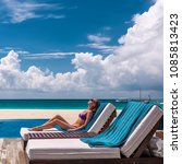 woman relaxing in lounger at... | Shutterstock . vector #1085813423
