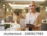 pretty smiling wedding planner... | Shutterstock . vector #1085817983