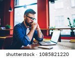 concentrated bearded young man... | Shutterstock . vector #1085821220