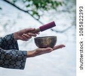 tibetan bowl  in woman's hands   Shutterstock . vector #1085822393
