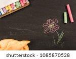 children drawing chalk on black ...