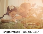 mother helping daughter with...   Shutterstock . vector #1085878814