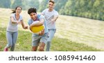 teenagers playing with ball in... | Shutterstock . vector #1085941460