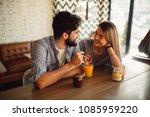 happy couple is drinking juice... | Shutterstock . vector #1085959220