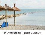 beach with umbrellas in the... | Shutterstock . vector #1085960504