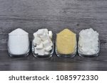Small photo of Cube sugar, raw sugar , crystalline sugar and granulation sugar in clear glasses with grey wooden background