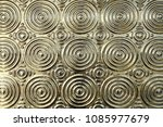 close-up metal surface with golden stacked layered circle embossed pattern, elegance gold metallic wall for interior home decor oriental style, abstract texture background