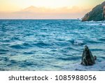 peaceful surf on shore of la... | Shutterstock . vector #1085988056
