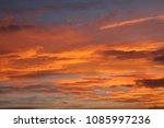 burning skies sunset | Shutterstock . vector #1085997236