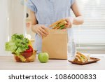 mother preparing sandwich for... | Shutterstock . vector #1086000833