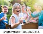 in summer. a group of friends... | Shutterstock . vector #1086020516
