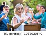 in summer. a group of friends... | Shutterstock . vector #1086020540