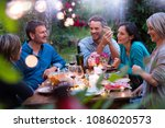 group of friends gathered... | Shutterstock . vector #1086020573