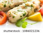 dish of boiled cod with parsley ... | Shutterstock . vector #1086021236