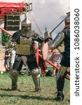 """Small photo of KUDROVO, RUSSIA - JULY 22, 2017 military historical reconstruction at the festival """"Rus' Druzhinnaya"""", Knights fight competition. Knight tournament."""