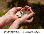euro on hand. many euro coins... | Shutterstock . vector #1086062228