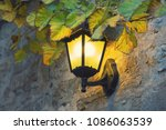 decorative lamp on a old  wall | Shutterstock . vector #1086063539