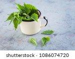 fresh nettle urtica ready to... | Shutterstock . vector #1086074720