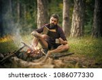 hipster hiker with book and mug ... | Shutterstock . vector #1086077330