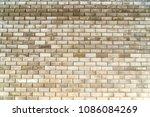 beige bricks wall background | Shutterstock . vector #1086084269