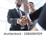 friendly handshake of business...   Shutterstock . vector #1086084509