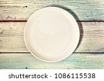 empty white plate on a wooden... | Shutterstock . vector #1086115538