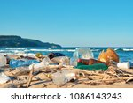 spilled garbage on the beach of ... | Shutterstock . vector #1086143243