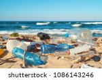 spilled garbage on the beach of ... | Shutterstock . vector #1086143246
