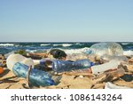 Spilled Garbage On The Beach O...
