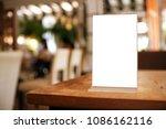 menu frame standing on wood... | Shutterstock . vector #1086162116