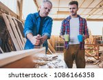 carpenters taking pause from... | Shutterstock . vector #1086166358