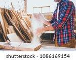 carpenter taking dirt outt of... | Shutterstock . vector #1086169154