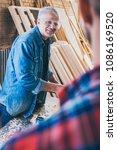 carpenters at work ... | Shutterstock . vector #1086169520