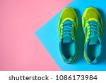 Pair of sport shoes on colorful ...