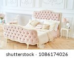 big royal bed with pillows in... | Shutterstock . vector #1086174026