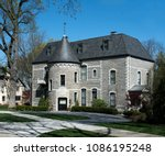 elegant gray stone mansion with ... | Shutterstock . vector #1086195248