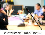 microphone and blur people in... | Shutterstock . vector #1086215930