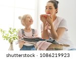 beautiful young woman and child ... | Shutterstock . vector #1086219923