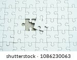 white jigsaw puzzle last missing   Shutterstock . vector #1086230063