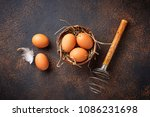 fresh  brown eggs in bowl and... | Shutterstock . vector #1086231698