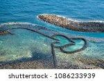 Small photo of Twin Hearts Stone Tidal Weir in Chimei island, Landmark of the Penghu Islands, Famous scenery in Taiwan.