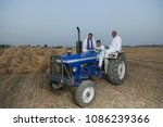 farmers sitting on tractor | Shutterstock . vector #1086239366