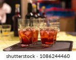 close up on cocktail glasses on ... | Shutterstock . vector #1086244460
