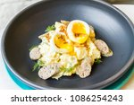 chicken sausage and hot boiled... | Shutterstock . vector #1086254243