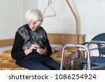 lonley elderly 95 years old... | Shutterstock . vector #1086254924