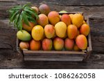 mango fruits in wooden box with ... | Shutterstock . vector #1086262058