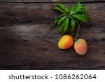 mango fruit with leaf on wooden ... | Shutterstock . vector #1086262064
